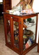antique glass cabinet.jpg (68771 bytes)